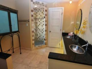 Luxurious bath including 5-jet walk-in shower, separate water closet and double vanity