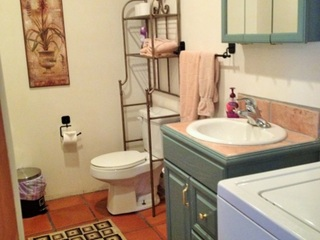 Half bath downstairs with laundry room